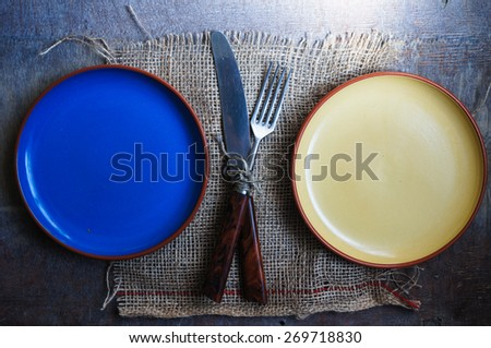 Table Setting with napkin and silverware on wooden table