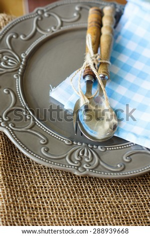 Table Setting with napkin and silverware on wooden table #288939668
