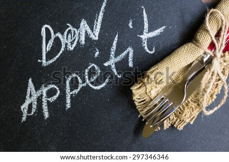 Table Setting with napkin and silverware on wooden table #297346346