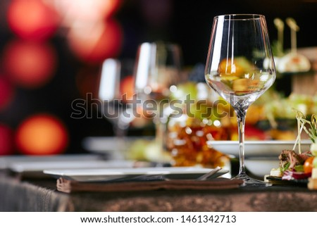 table setting with snacks and glasses