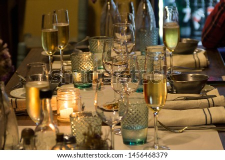 Table settings for private event, including cutlery, wine glasses, napkins and candles to set the mood for wining and dining