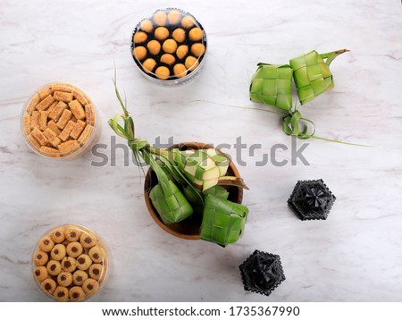 Table Situation for Ied Fitri, Kue kering and Ketupat Top View White Background  Сток-фото ©