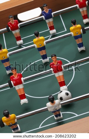 Table soccer/ Football players on the grass field background. Table game.