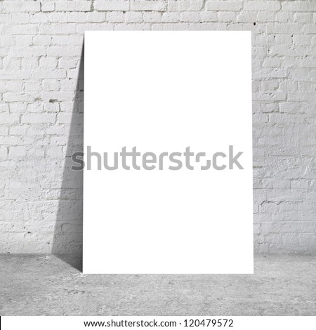 table standing next to a brick wall - stock photo
