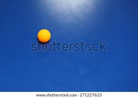 Table Tennis Ball. Ping pong, blue table, orange ball
