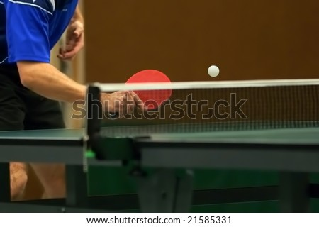 table tennis player returning ball, focus at the ball!