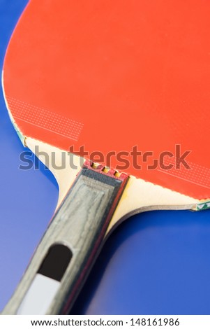 Table tennis racket. Close-up of red table tennis racket
