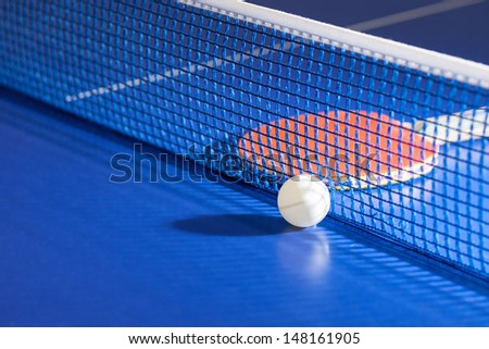Table tennis racket. Top view of table tennis racket and ball lying on the tennis table