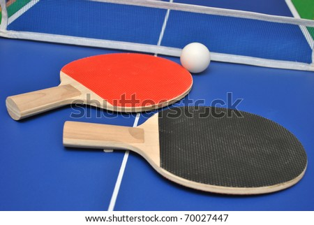 Table tennis rackets and ball on tennis table