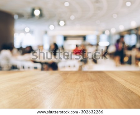Table top Counter with Blurred People and Restaurant Shop interior background #302632286