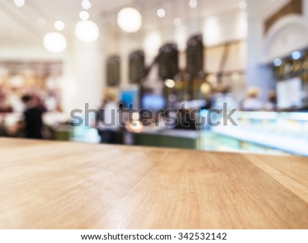 Table top Counter with Blurred People and Restaurant Shop interior background #342532142