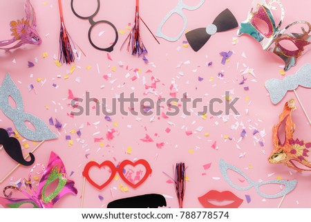Table top view aerial image of beautiful photo booth prop for party carnival background concept.Flat lay objects with paper craft on modern rustic pink wallpaper at home office desk with copy space.