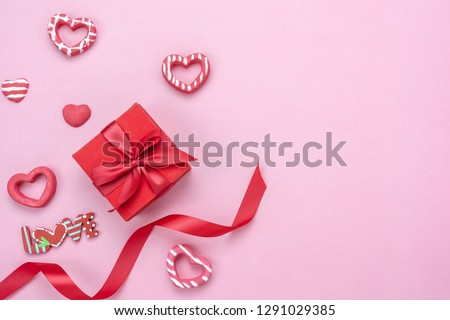 Table top view aerial image of decoration valentine's day background concept.Flat lay essential items gift box with ribbon & love season on modern pink paper.blank space for mock up creative design.