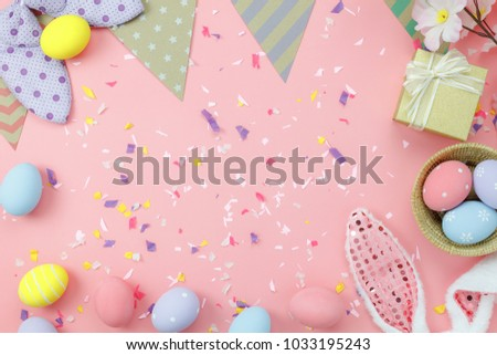Table top view shot of arrangement decoration Happy Easter holiday background concept.Flat lay colorful bunny egg with accessory to celebration on modern rustic pink pastel paper at home office desk. - Shutterstock ID 1033195243