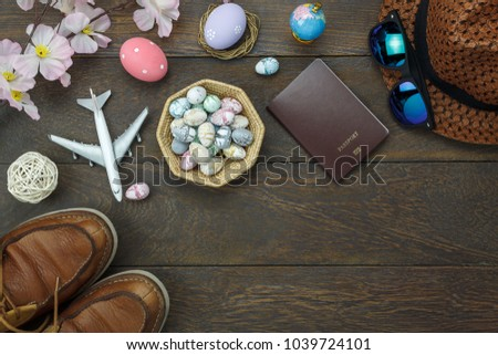 Table top view shot of decoration Happy Easter holiday background concept.Flat lay essential objects plan to travel vacation on modern brown wood at office desk.space design mock up.item to traveler. #1039724101