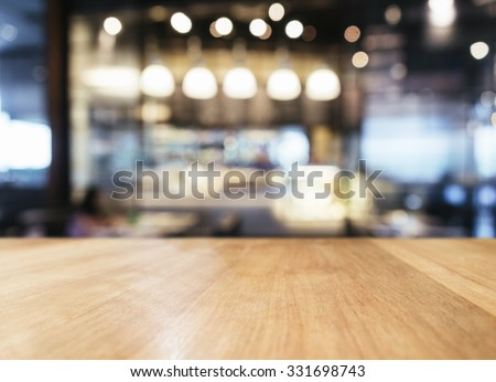Table top with Blurred Bar restaurant cafe interior background #331698743