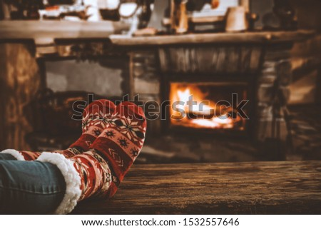 Table top with blurred fireplace and cosy home interior background. #1532557646