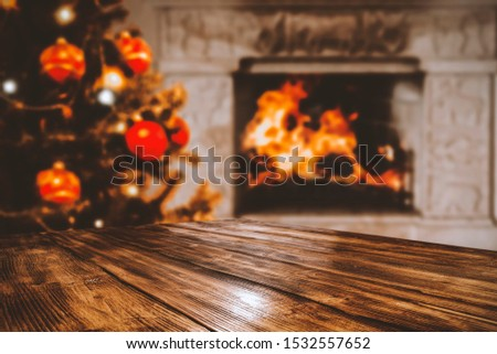 Table top with blurred fireplace and cosy home interior background. #1532557652