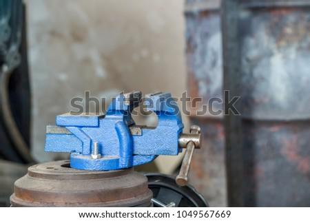 Table vise ,Vise tool in workshop. Tools for industry , vise stand on the table - Shutterstock ID 1049567669