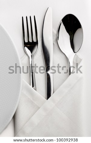 Table which served tableware wrapped in a napkin