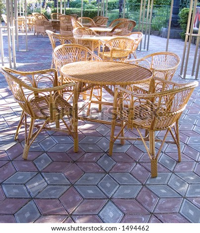Table with chairs in cafe