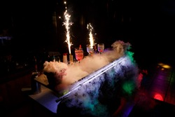 Table with cocktails and dry ice. Cocktail party.