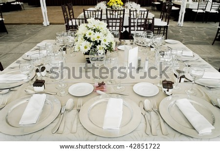 table with dishes and ornaments ready for a celebration