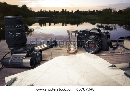 table with fishing and photography items