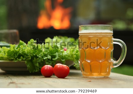 table with fresh vegetables and beer