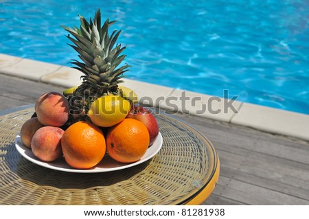 table with fruit by the pool