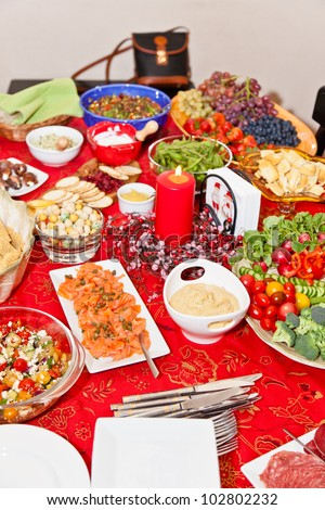 Table with lots of different foods for Christmas party.