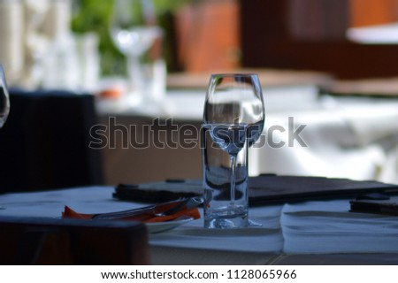 Table with plate and glasses #1128065966