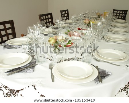 Table with plates and glasses before a party