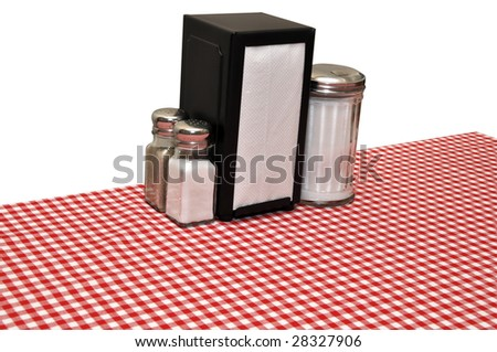 Table with red gingham tablecloth at diner.  Isolated on white background with clipping path.