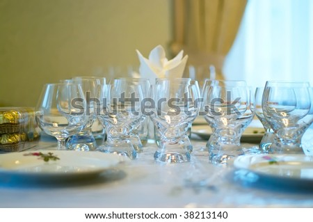 Table with tablewares covered by a holiday