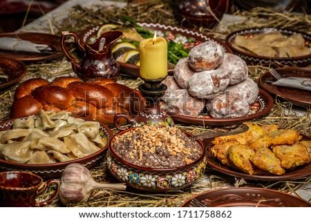 Table with traditional Ukrainian homemade food. Traditional Ukrainian dinner. Orthodox Christmas Eve. Photo stock ©