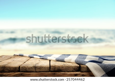 tablecloth and table of wood and sea  #257044462