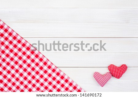Tablecloth textile and love hearts on wooden table background