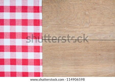 Tablecloth textile texture on wooden table background