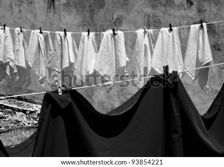 Tablecloths and napkins are dried on a rope (black and white) - Mexico