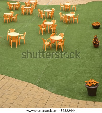 Tables and beautiful chairs in empty open air cafe