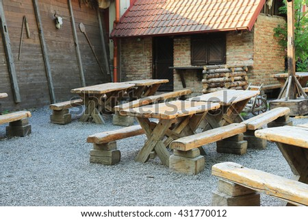 Tables and benches with entourage in medieval style