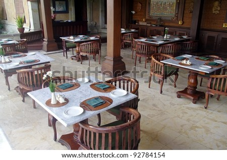 Tables and chairs in a restaurant, Ubud, Bali, Indonesia.