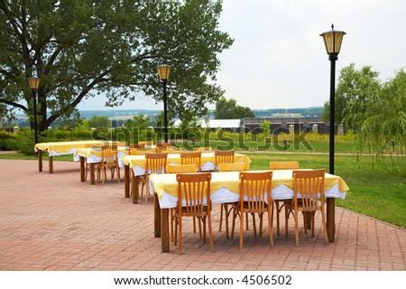 Tables and chairs in cafe on fresh air