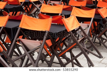 Tables and chairs in closed open-air cafe