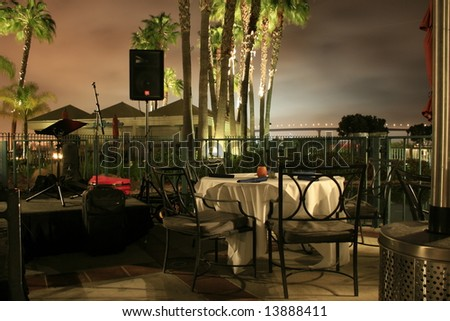 Tables and chairs in restaurant at night time