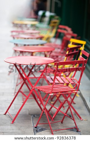 tables and chairs in the street