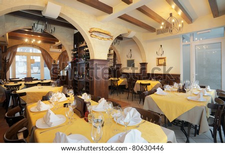 Tables, chairs and lighting equipment of a restaurant.