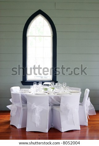 stock photo Tables decorated at a wedding reception held in a church hall