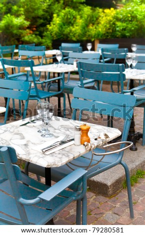 tables on the street, french restaurant - Paris, France